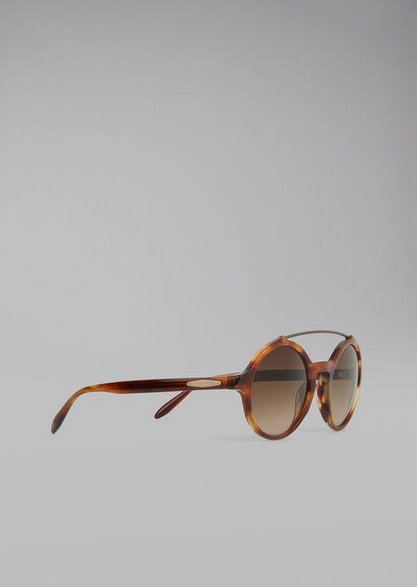 Солнцезащитные очки в круглой оправе с металлическими деталями