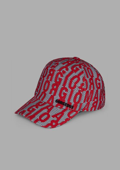 Hat with fabric peak and logo lettering