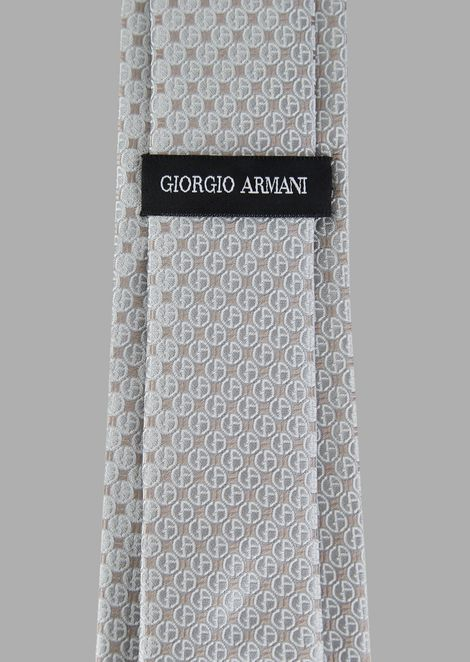 Silk tie with jacquard logo pattern