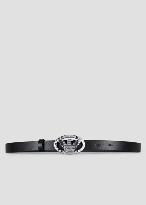 Slender belt with rhinestone decorated oval logo