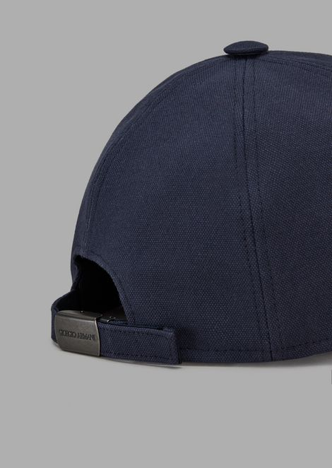 Hat with peak and embroidered logo