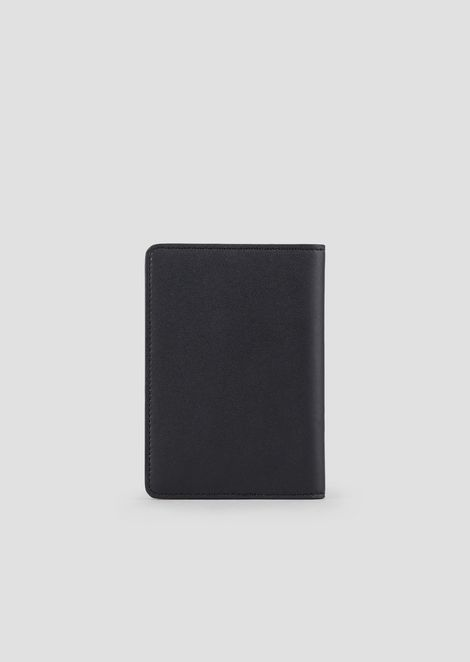Leather passport holder with triangular detail in metal