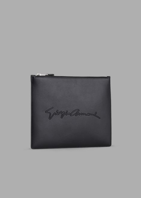 Leather pochette with etched signature