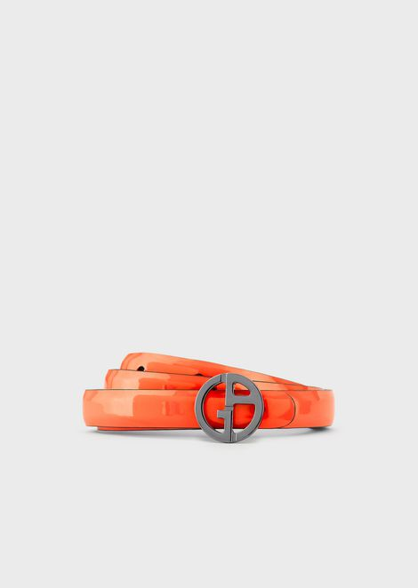 Slender, reversible leather belt with round logo