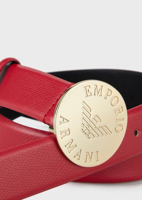 Belt with round buckle and engraved logo