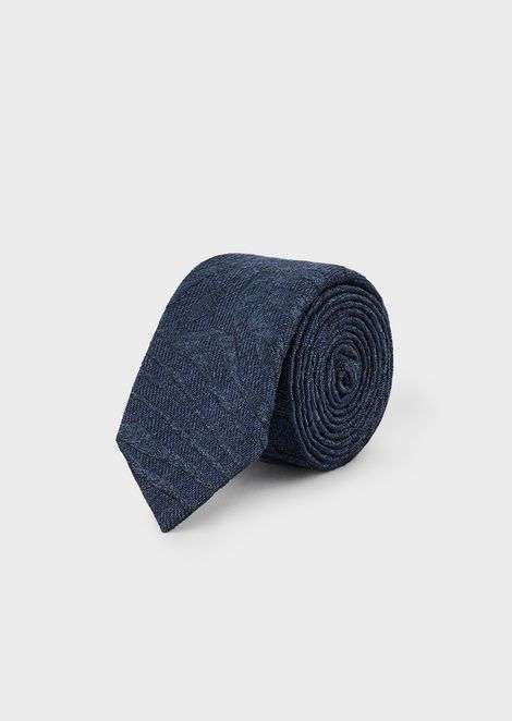 Tie in a silk/wool blend with jacquard zebra motif