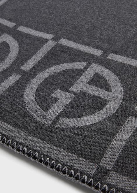 Editore rug made of pure wool with embroidered edging