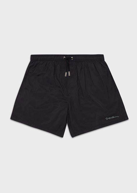 Swimming trunks with logo pattern