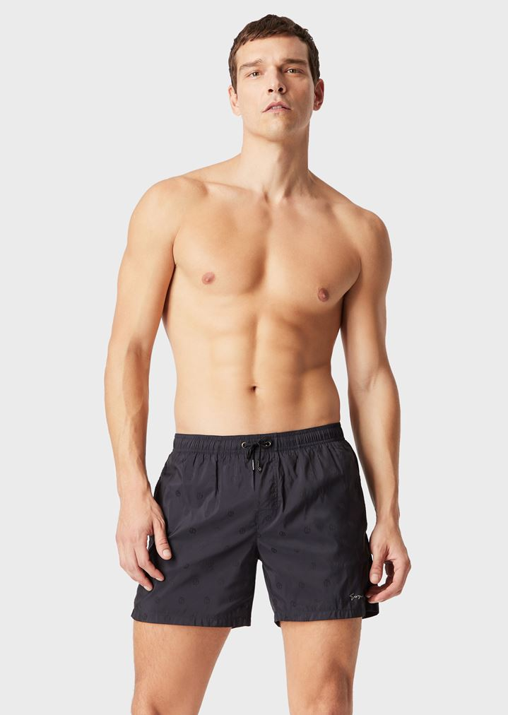 04482db76e Swimming trunks with logo pattern