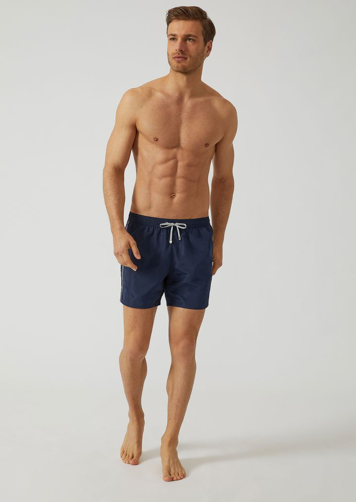 8966c37847 Swim shorts in technical fabric with branded band   Man   Ea7