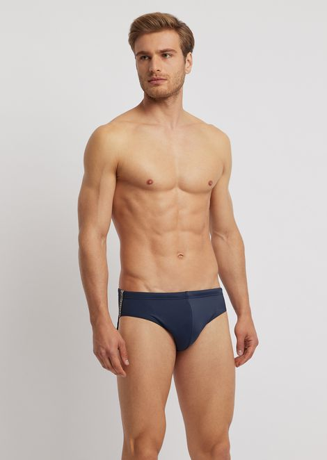 d486f2a5da Tech fabric swimming briefs with logo band on the side