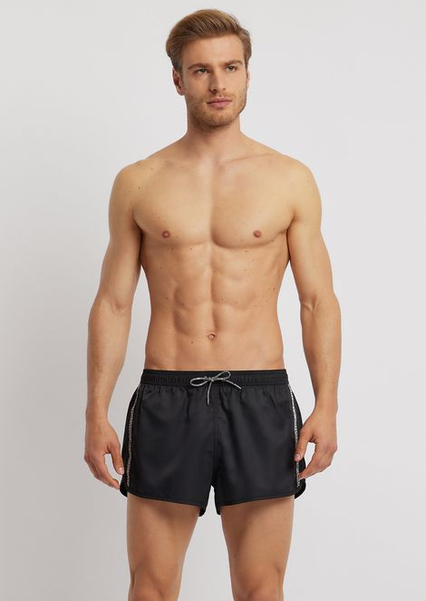 Swimming shorts in tech fabric with logo band at the side