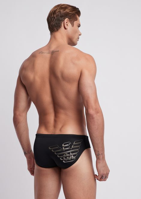 Single-colour swimming briefs with printed logo on the back