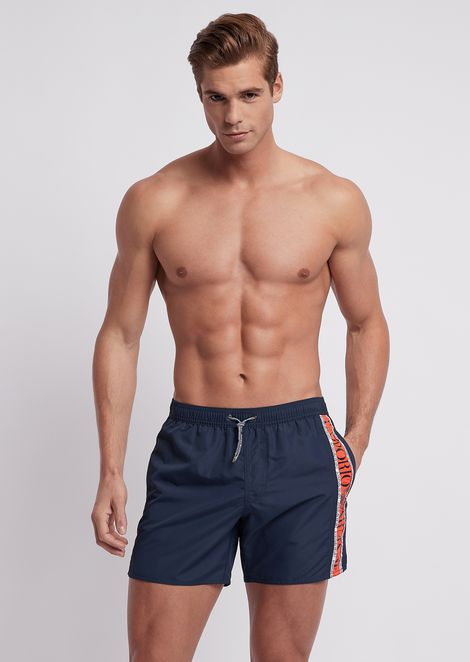 2d2c8c2532 Swimming shorts in tech fabric with logo band at the side
