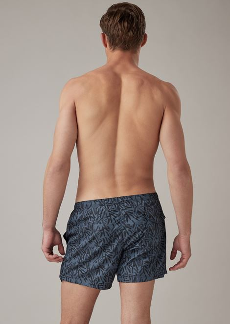 Swimming shorts in abstract patterned fabric