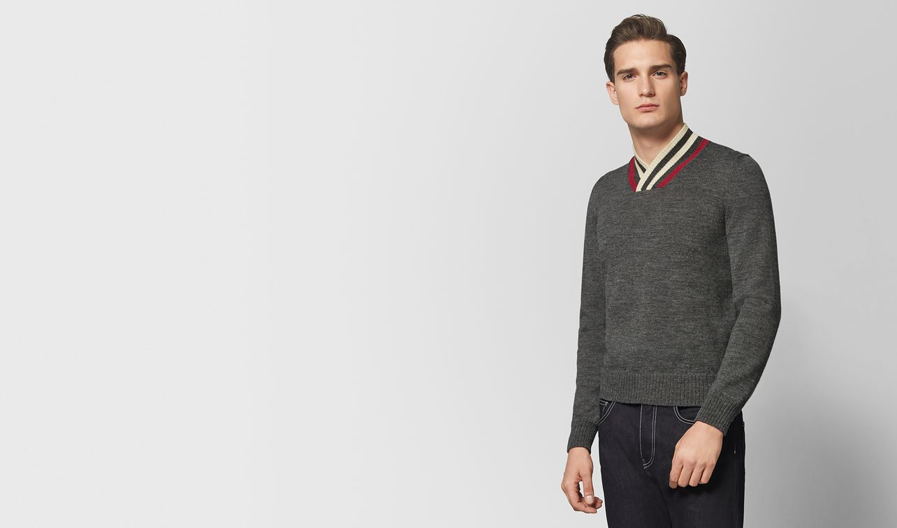 dark grey wool sweater landing
