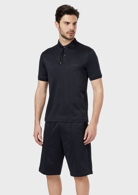 Polo shirt in cotton interlock fabric with appliquéed flocked studs