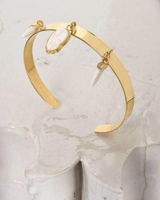 Golden bracelet with charms
