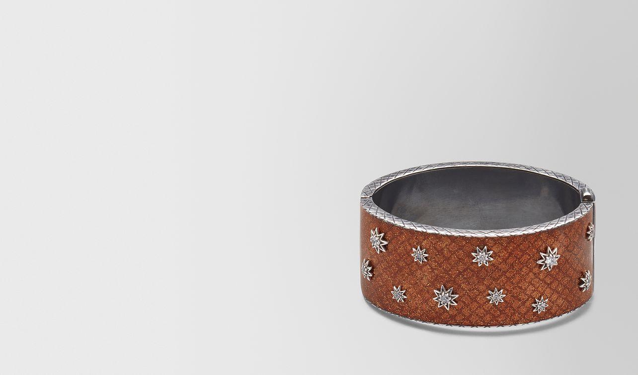 brown antique silver stellular cuff landing
