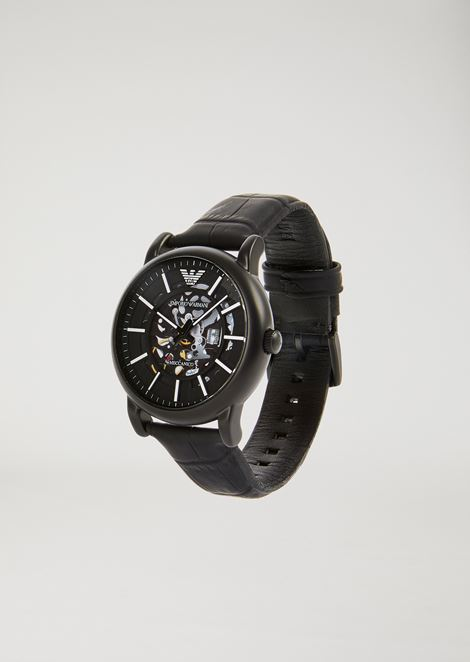 Men's watch with visible gears and leather strap
