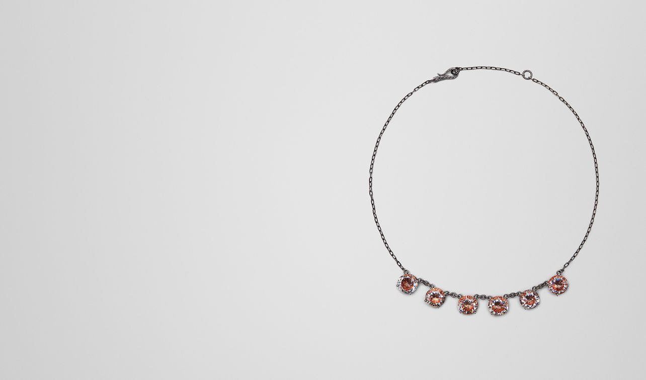 necklace in silver and naturale brown cubic zirconia, intrecciato detail landing