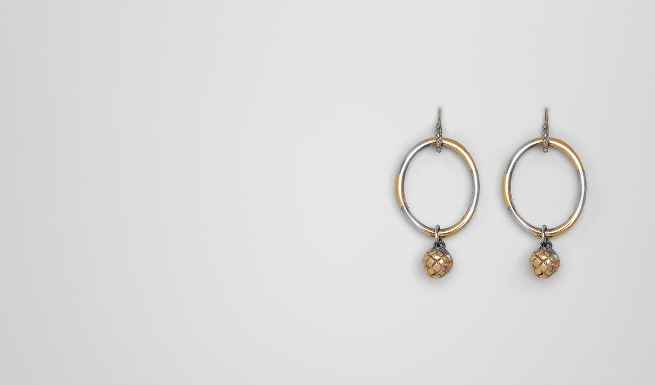 boucles d'oreilles dichotomy avec patine en or jaune/antique silver landing