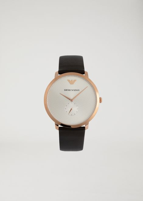 Watch with round rose gold dial and smooth leather strap