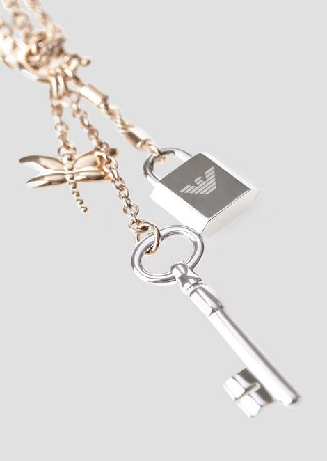 Колье из нескольких цепочек с подвесками в виде стрекозы, ключа и замочка