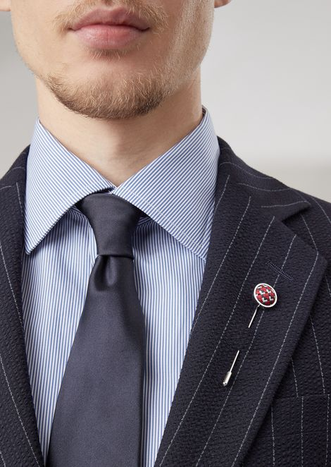 Silver lapel pin with tie-fabric decoration