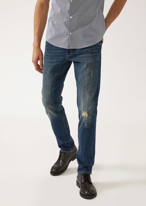 J06 sand-washed jeans with decorative tears and rips