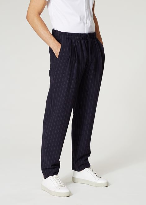 Trousers with pleats in plain pinstripe ramie blend fabric