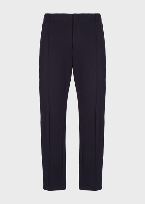 Plain-coloured jersey trousers with raised crease line