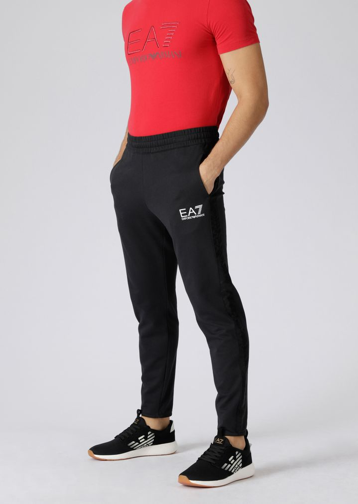 fd93bf540b64c0 Pure cotton Train Logo jogging pants | Man | Ea7
