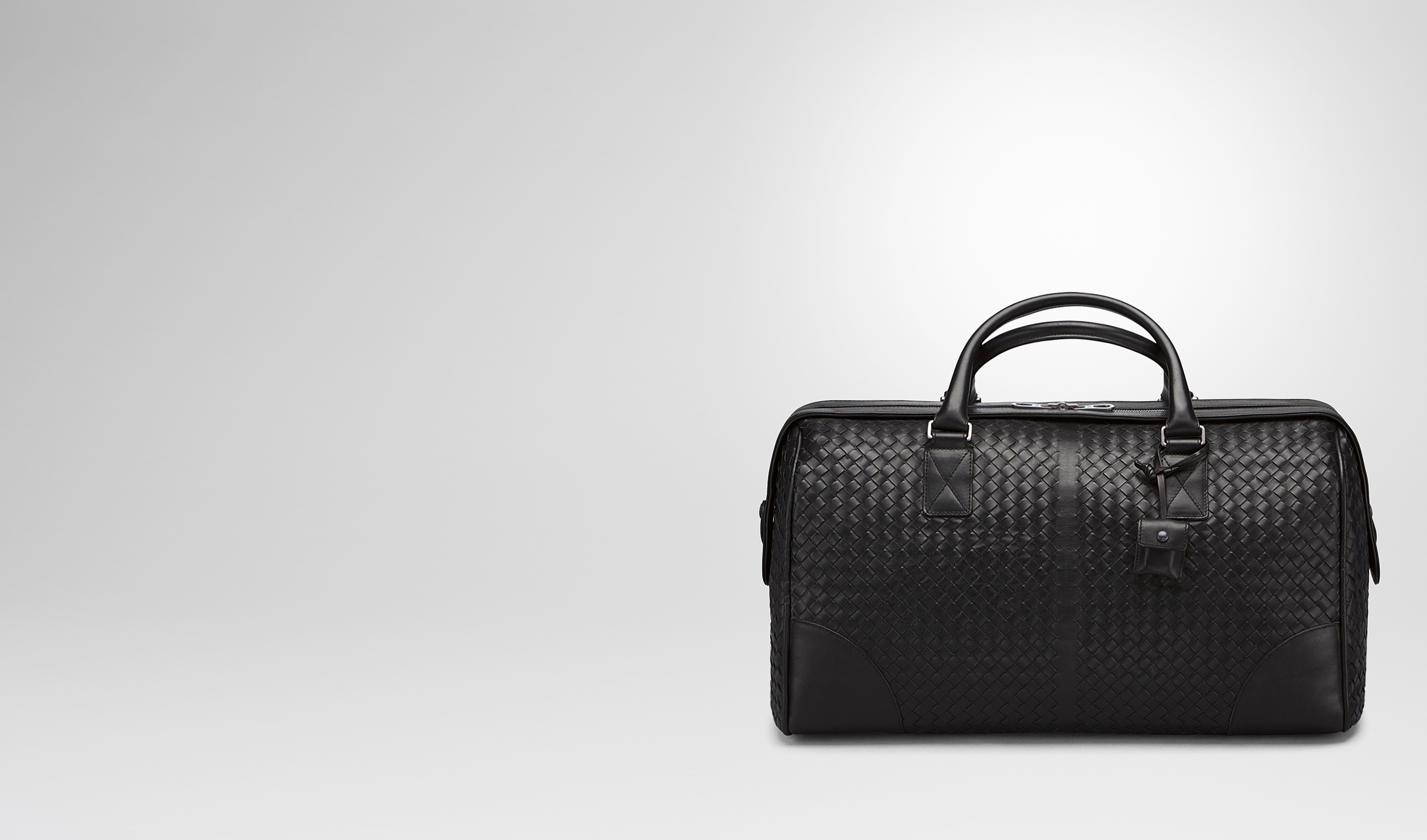 BOTTEGA VENETA Trolley and Carry-on bag E MEDIUM DUFFEL BAG IN NERO INTRECCIATO VN pl
