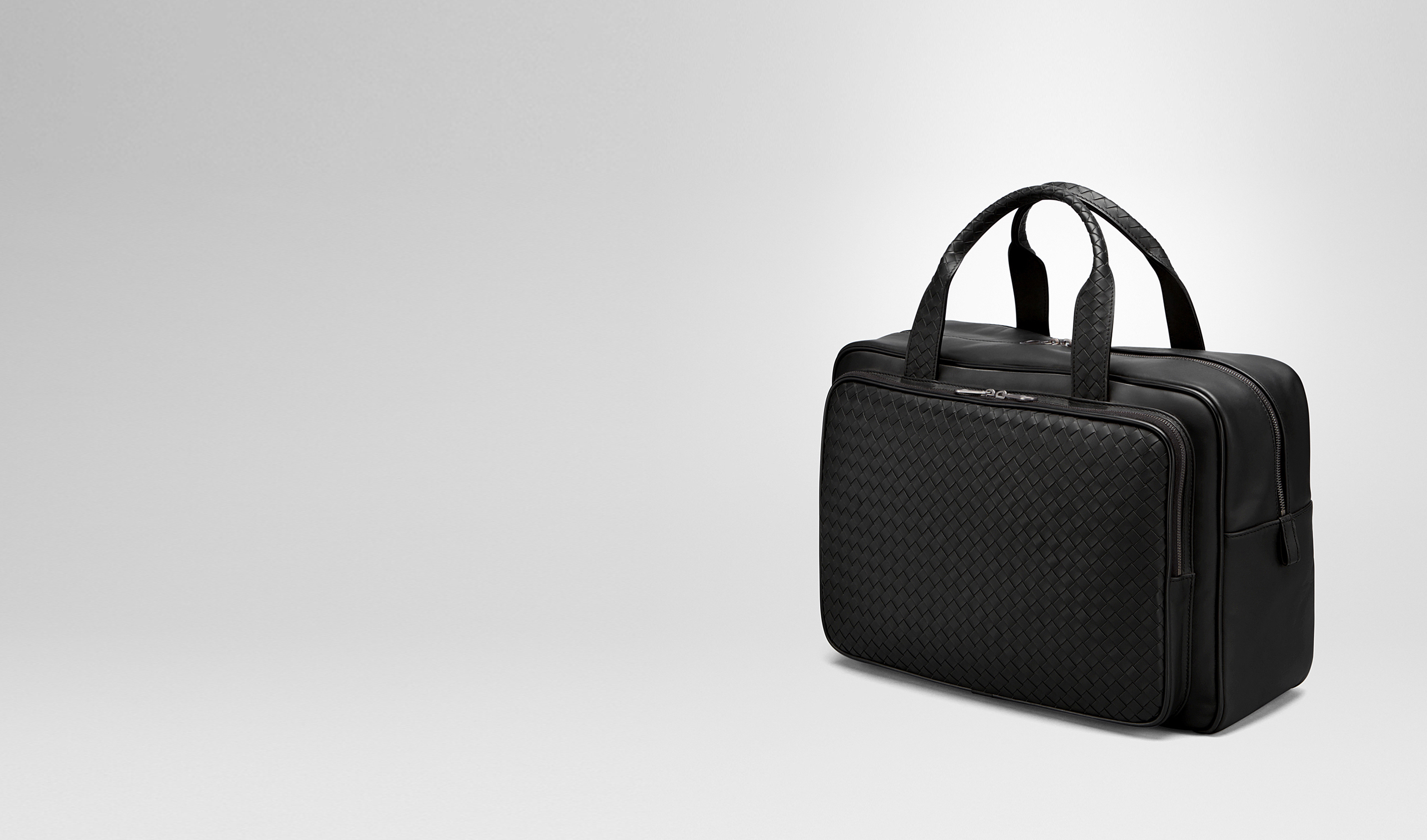 BOTTEGA VENETA Trolley and Carry-on bag E TRAVEL BAG IN NERO INTRECCIATO VN pl