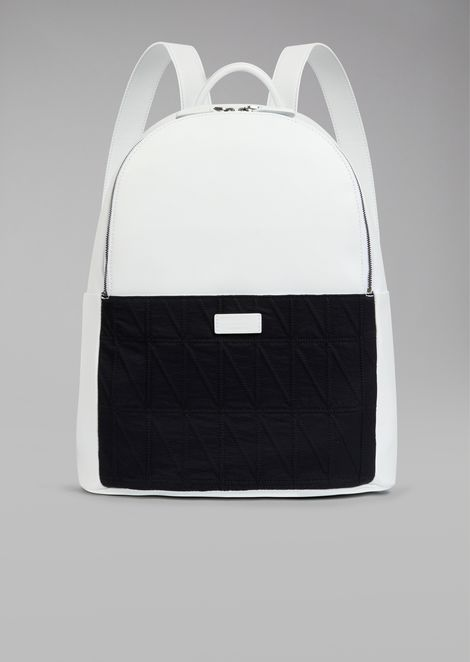 Backpack with diamond pattern fabric insert