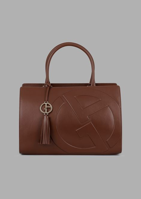a6bbfe8656c2 Cabas hand bag in leather with raised GA logo