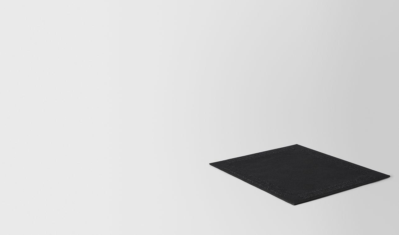 nero intrecciato linen placemat landing