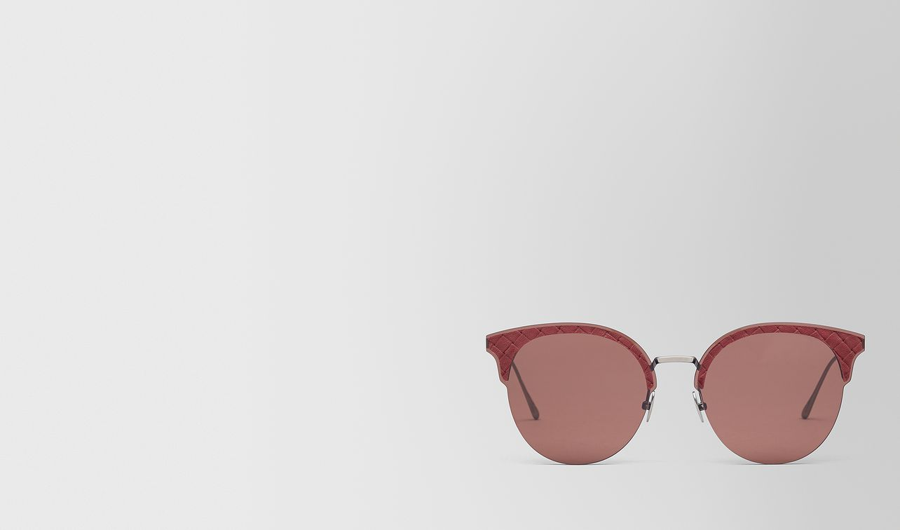 red metal sunglasses landing