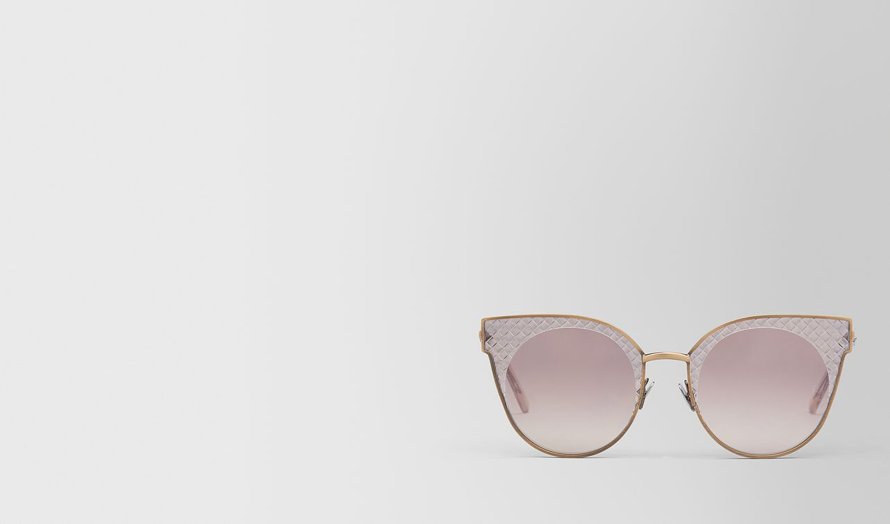 bronze metal sunglasses landing