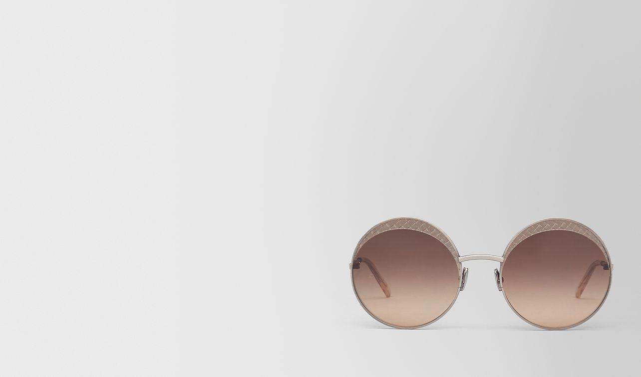 silver metal sunglasses landing