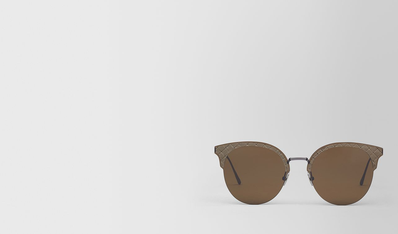 brown metal sunglasses landing