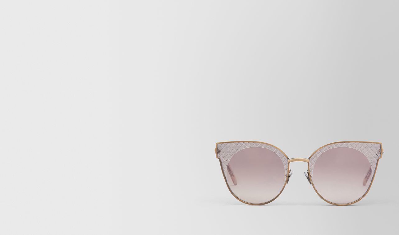 bronze metal sunglasses landing