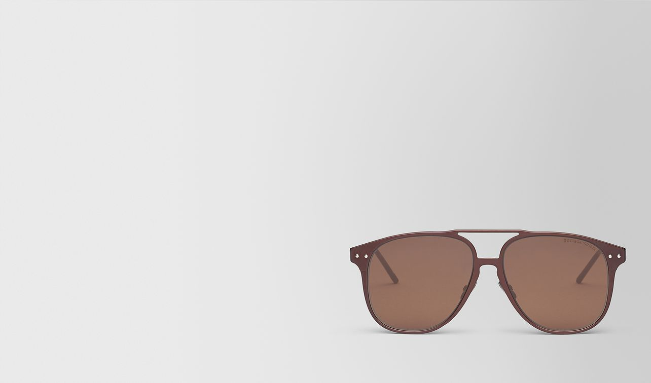 brown aluminum sunglasses landing