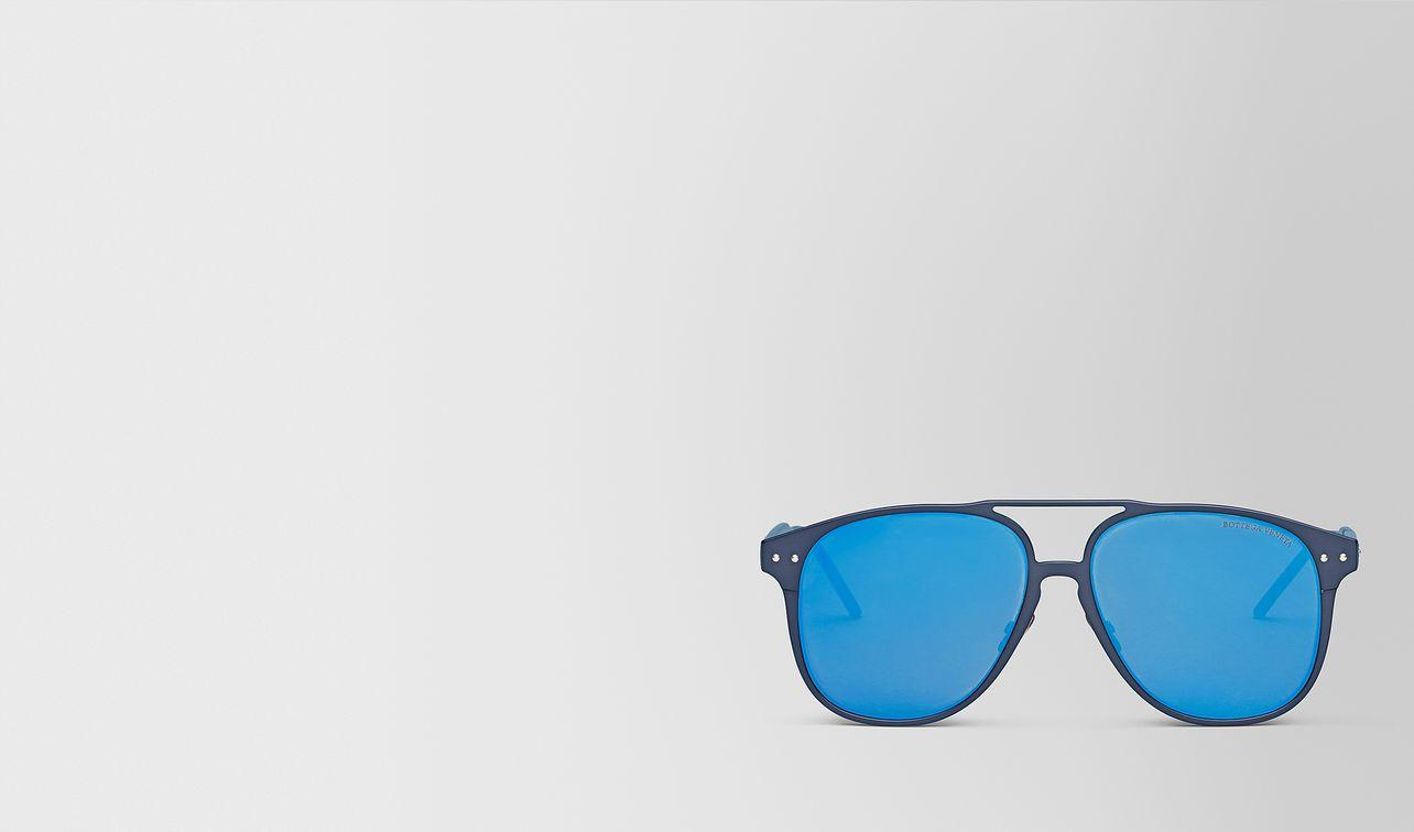 blue aluminum sunglasses landing