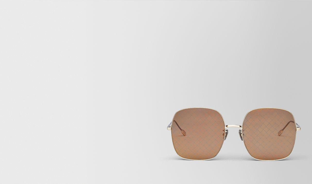 sonnenbrille aus metall in gold landing
