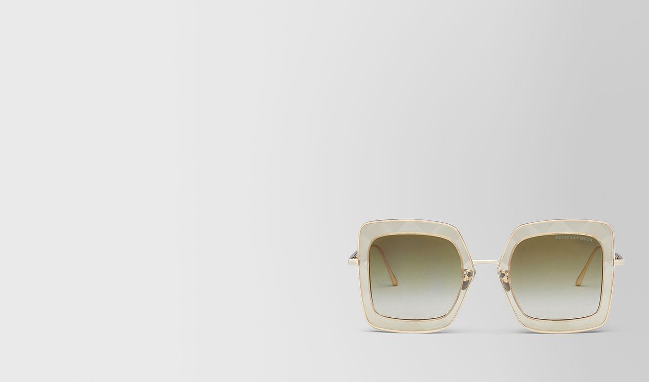 yellow metal sunglasses landing