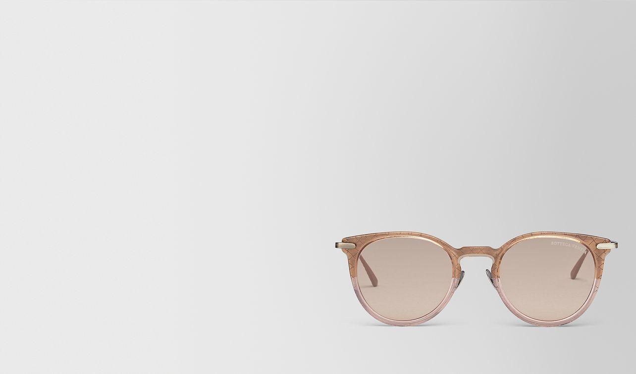 brown metal sunglasses landing