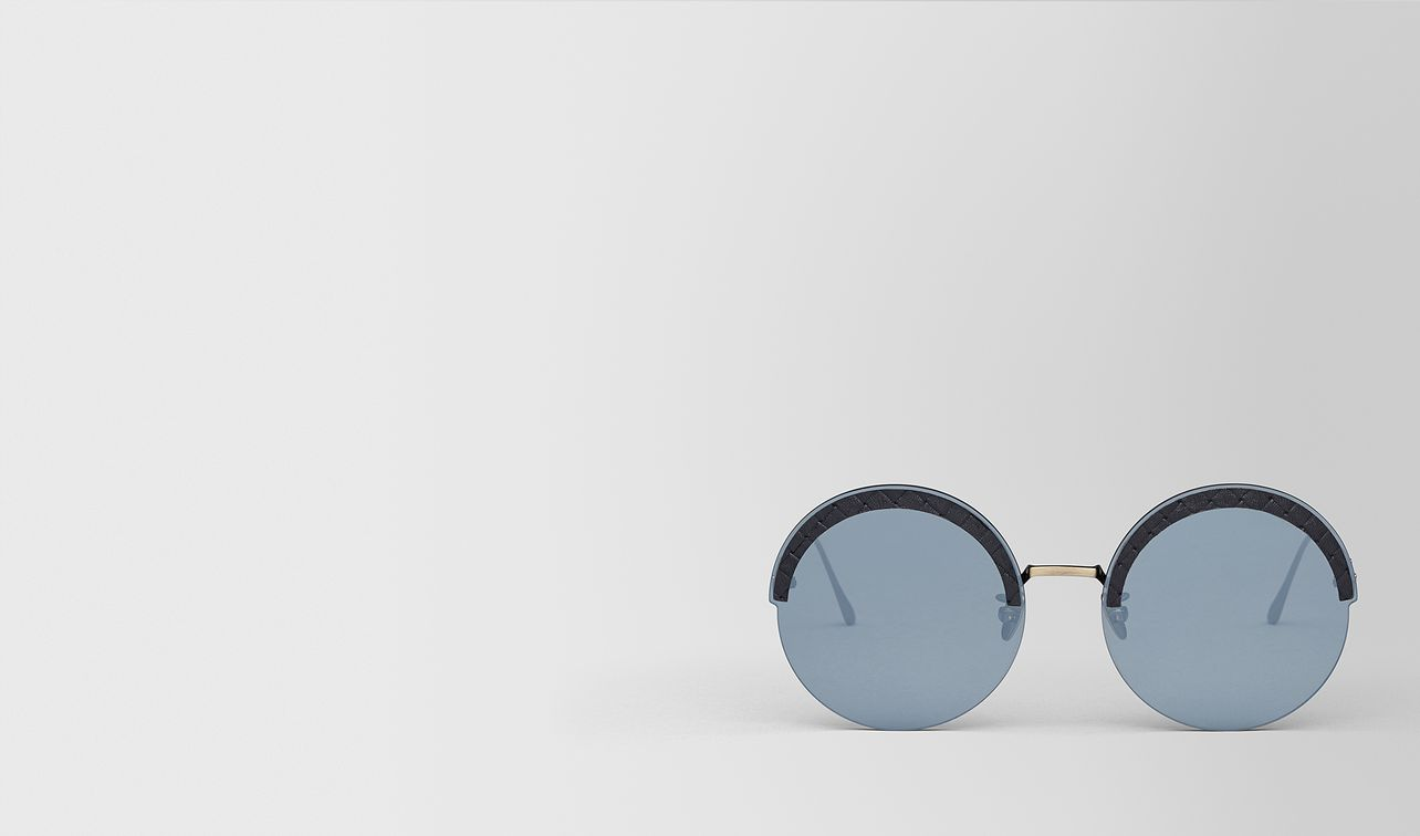 gold metal/leather sunglasses landing