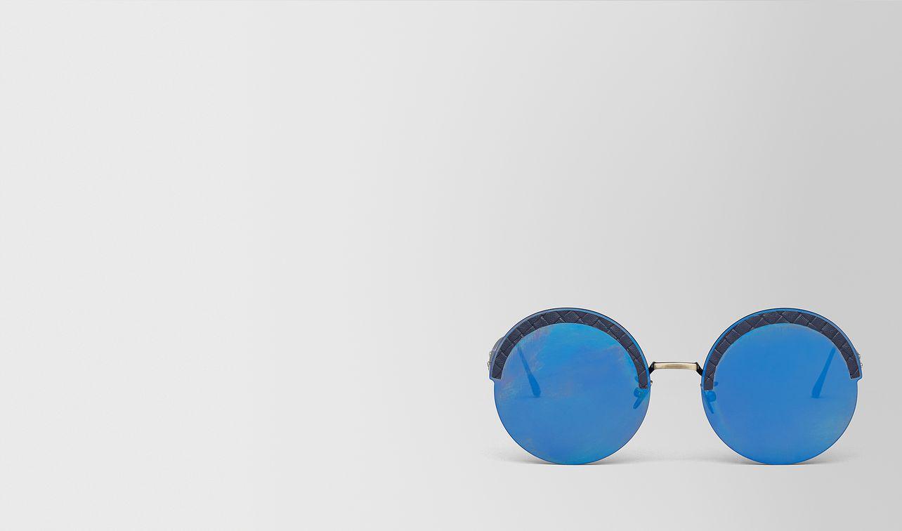 gold metal/leather sunglasses landing